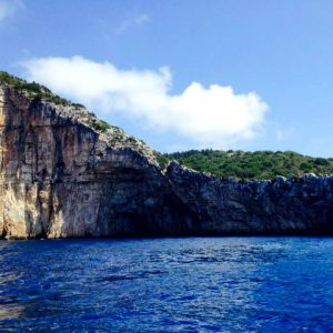 paxos west side blue waters dramatic cliffs green scenery