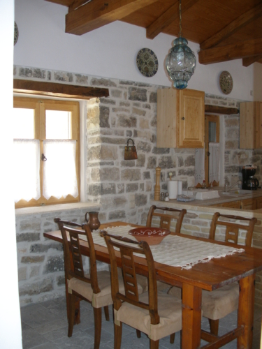 monolitharo traditional cottage accommodation in paxos greece with kitchen and dinner table